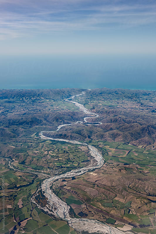Aerial view of the Waiau River winding its way out to the sea, North Canterbury, South Island New Zeland by Angela Lumsden for Stocksy United