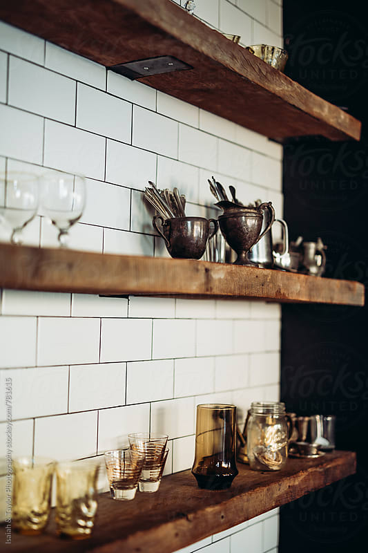 Dishes on shelves by Isaiah & Taylor Photography for Stocksy United