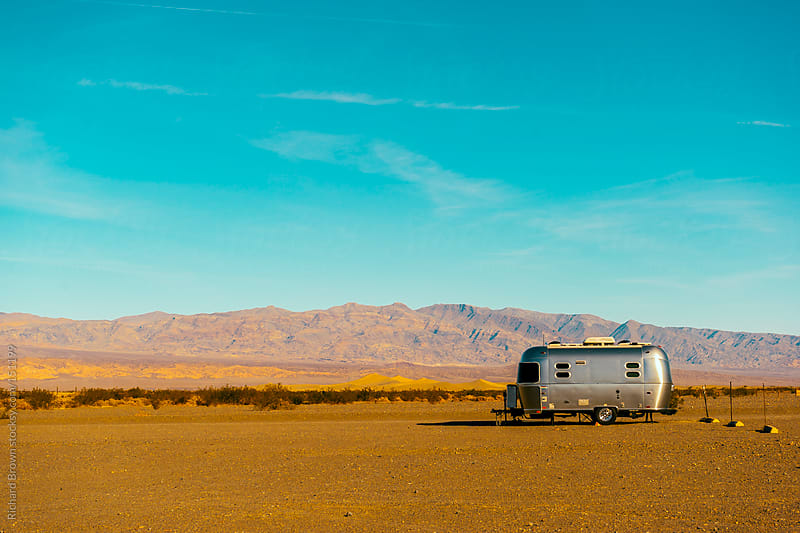 Camper in the desert by Richard Brown for Stocksy United