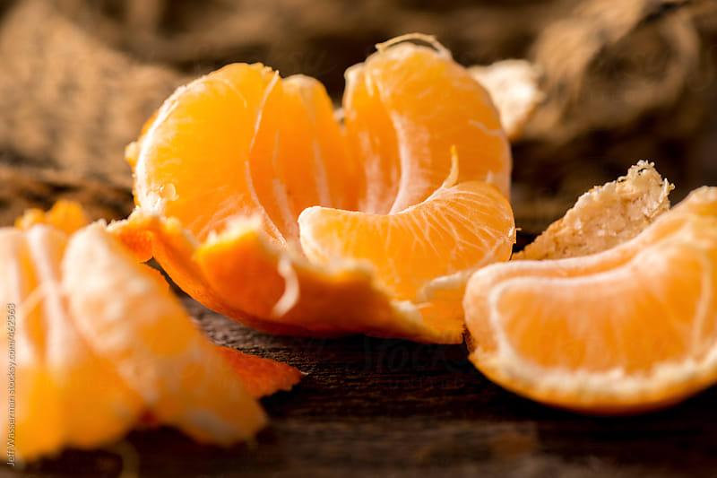 Mandarin Orange on Wood by Jeff Wasserman for Stocksy United