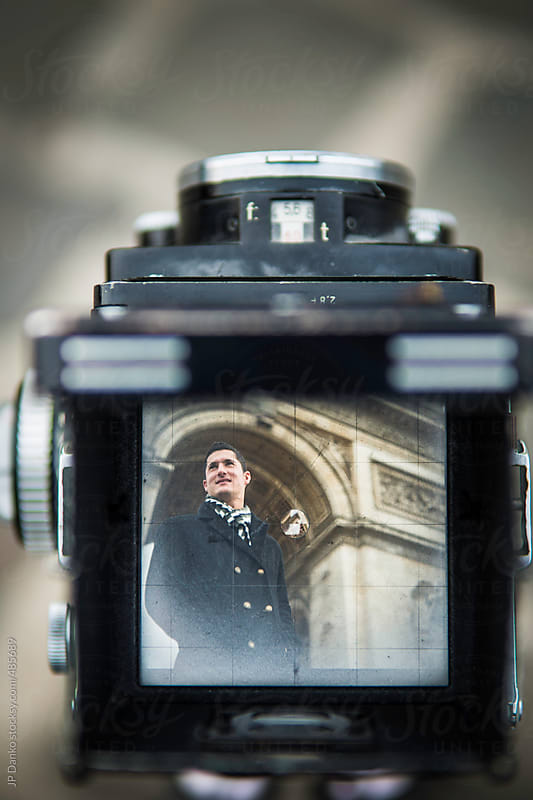Vintage Film Medium Format Camera Photographing the Man With Arc de Triomphe Paris by JP Danko for Stocksy United