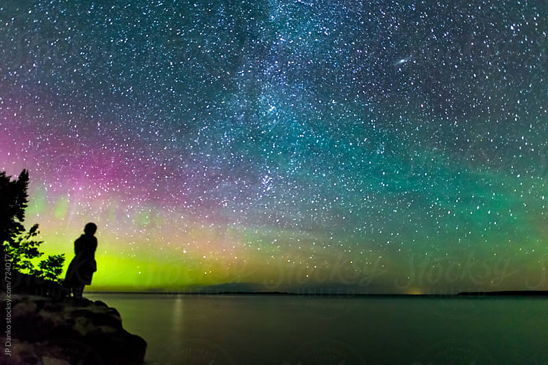 Boy Watching The Perseids Meteor Shower With The Milky Way and Northern Lights On Summer Vacation by JP Danko for Stocksy United