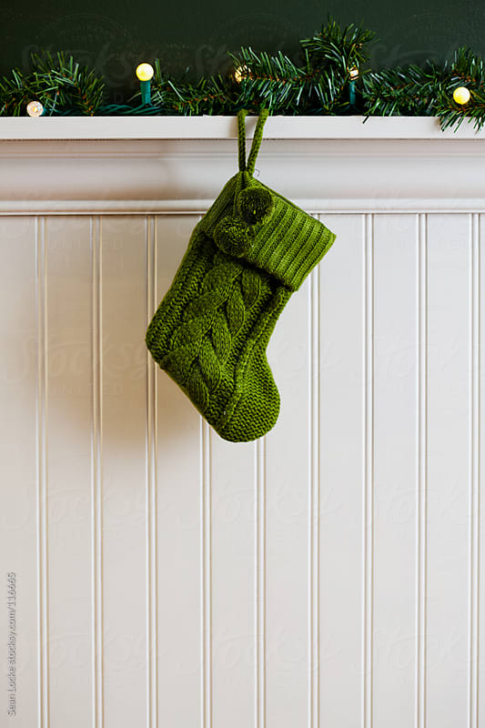 Holidays: Small Green Knitted Christmas Stocking by Sean Locke for Stocksy United