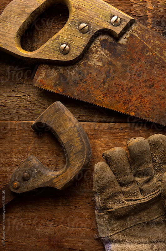 Rusty Saws and Work Glove by Jeff Wasserman for Stocksy United