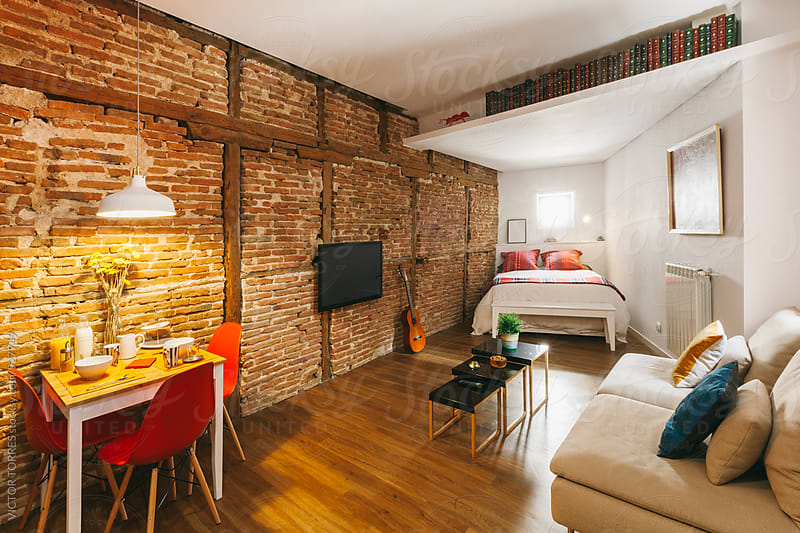 Cozy Apartment with Brick Walls by Victor Torres for Stocksy United