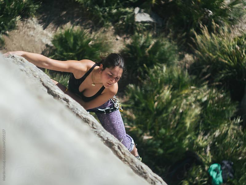 Fit girl  climber Climbing on el chorro rocks in spain by Martin Matej for Stocksy United