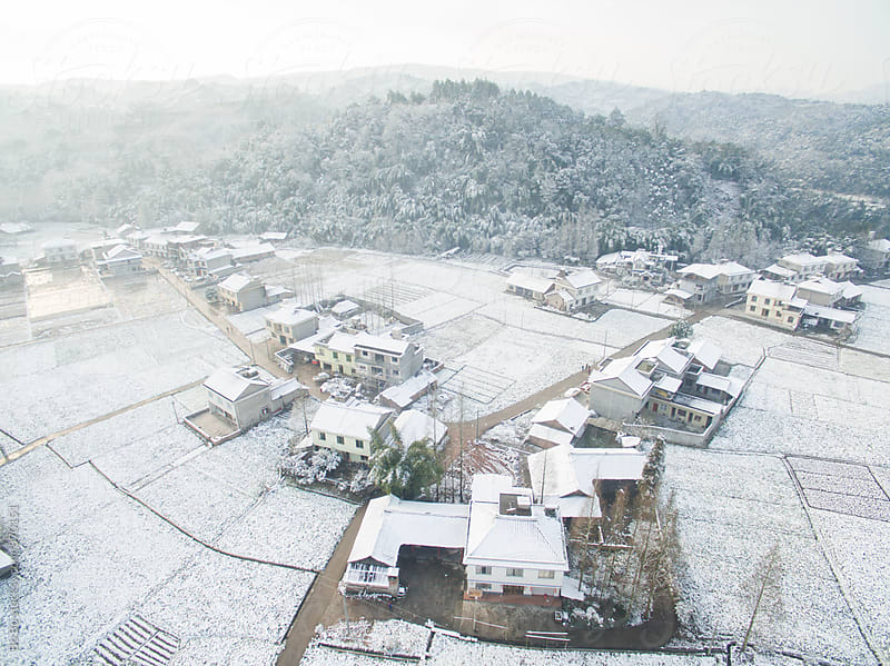 small village in the winter by Bo Bo for Stocksy United