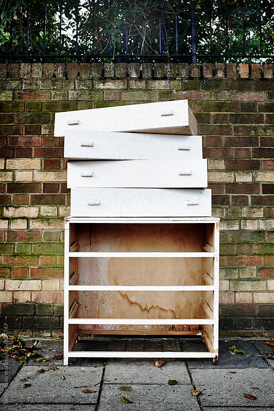 A white chest of drawers by James Ross for Stocksy United
