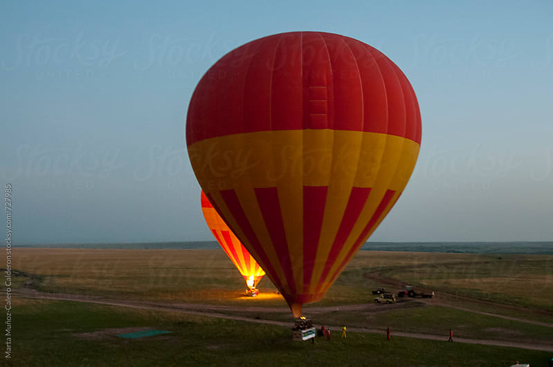 Hot Air Balloon in Sky during de sunrise by Marta Muñoz-Calero Calderon for Stocksy United