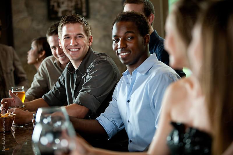 Bar: Man Flirting with Woman by Sean Locke for Stocksy United