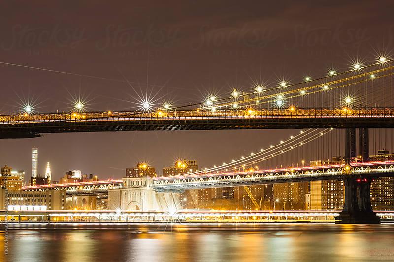 Bridges of New York by night by michela ravasio for Stocksy United