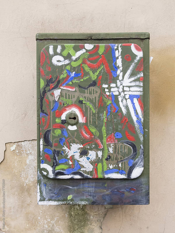 Metal outdoor box covered with colorful paint by Melanie Kintz for Stocksy United