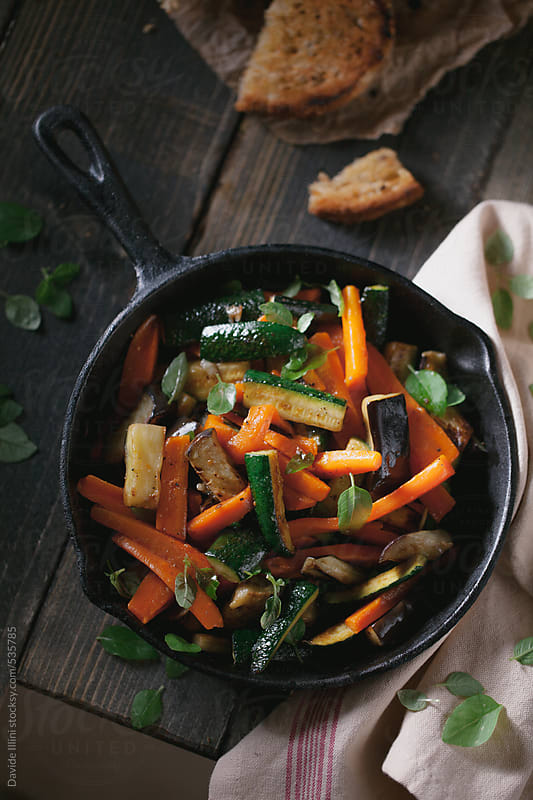 Mixed vegetables roasted in a pan by Davide Illini for Stocksy United
