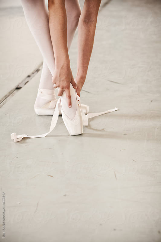 Ballet: Student Removing Pointe Shoe by Sean Locke for Stocksy United