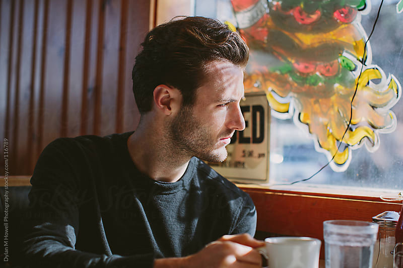 man sitting in diner stock image from stocksy united