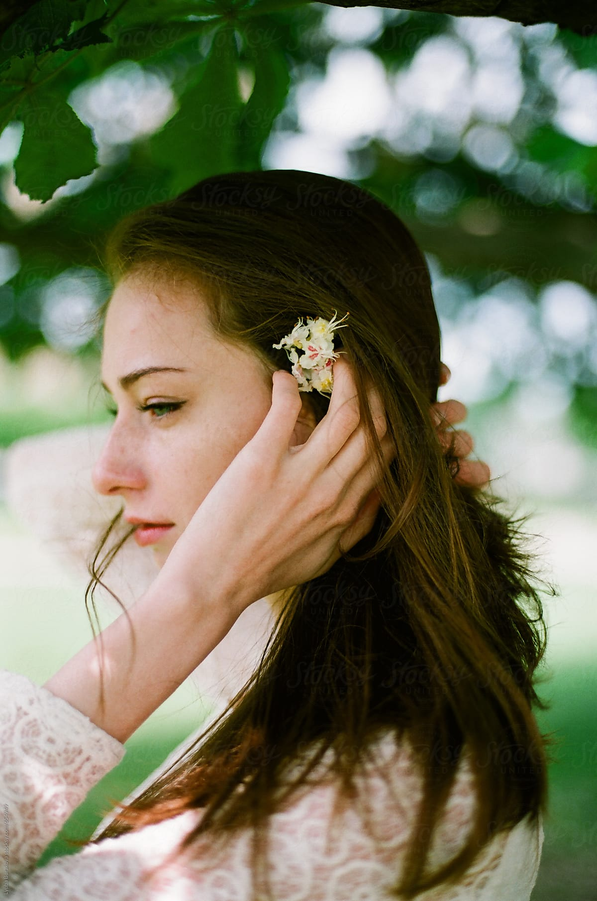 Portrait of beautiful woman with flower on her hair stocksy united portrait of beautiful woman with flower on her hair by lyuba burakova for stocksy united izmirmasajfo