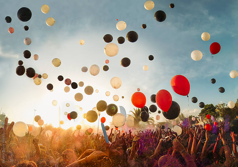 Big festival outdoors with music and balloons by Beatrix Boros for Stocksy United