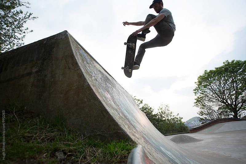 Skateboarder practising his skills.  by Hugh Sitton for Stocksy United