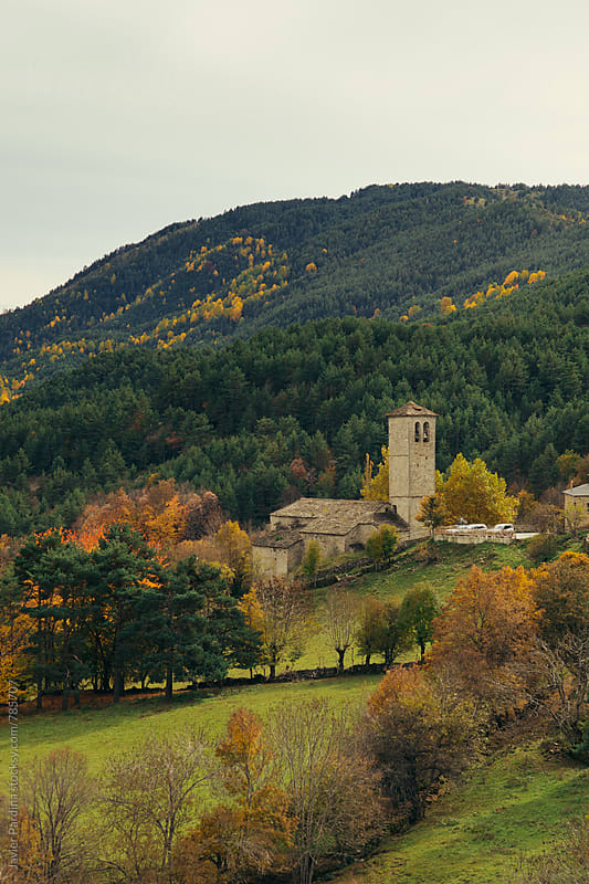 old church among the autumn trees by Javier Pardina for Stocksy United