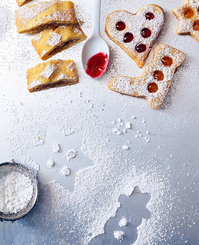 Christmas biscuits with icing sugar by J.R. PHOTOGRAPHY for Stocksy United