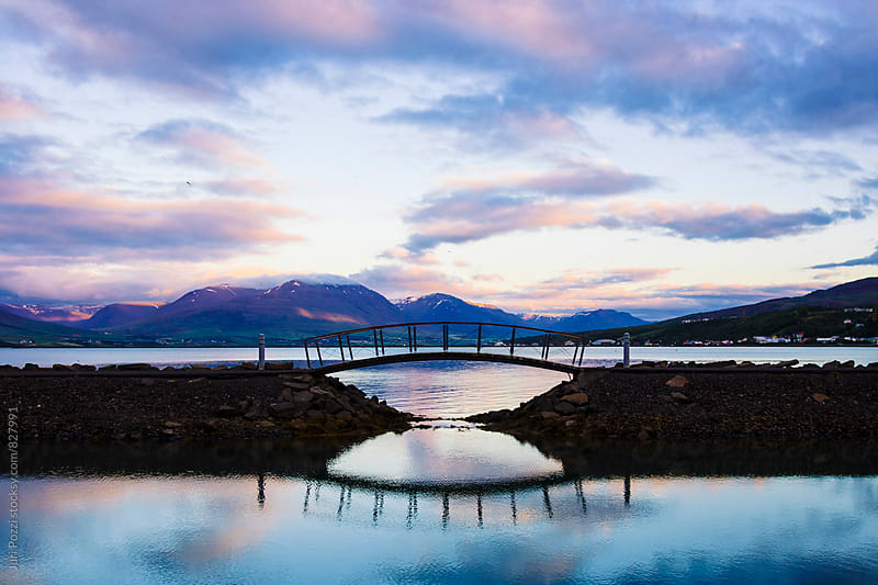 a small wooden bridge in iceland by Juri Pozzi for Stocksy United