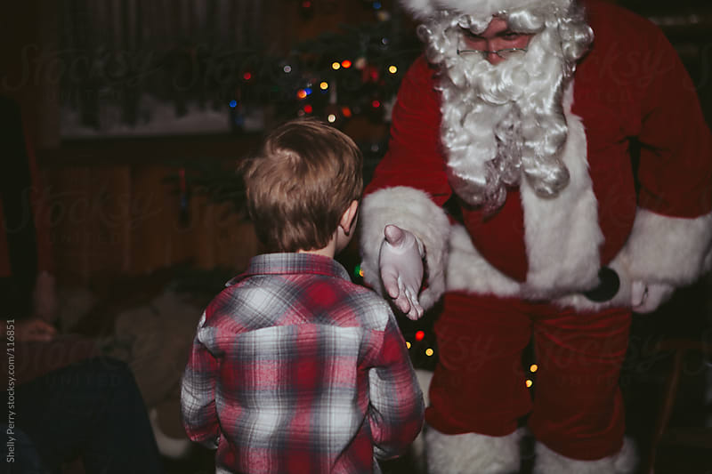 Little boy meets Santa by Shelly Perry for Stocksy United
