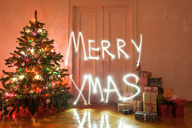 Merry Christmas Written With Light by Mosuno for Stocksy United