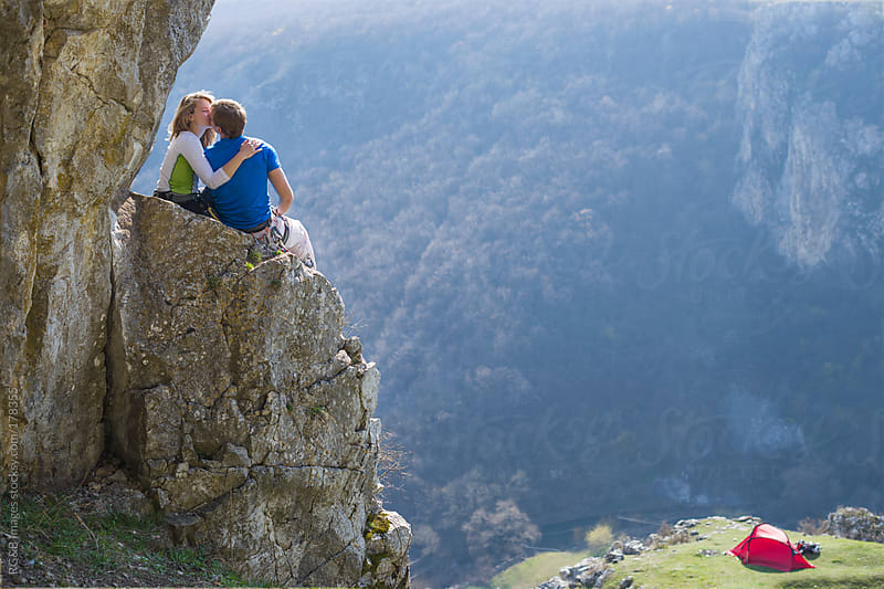 couple kissing on the cliff  by RG&B Images for Stocksy United