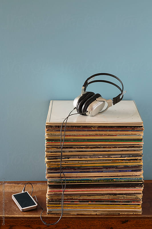Vinyl record albums, headphones and a mobile phone by David Smart for Stocksy United
