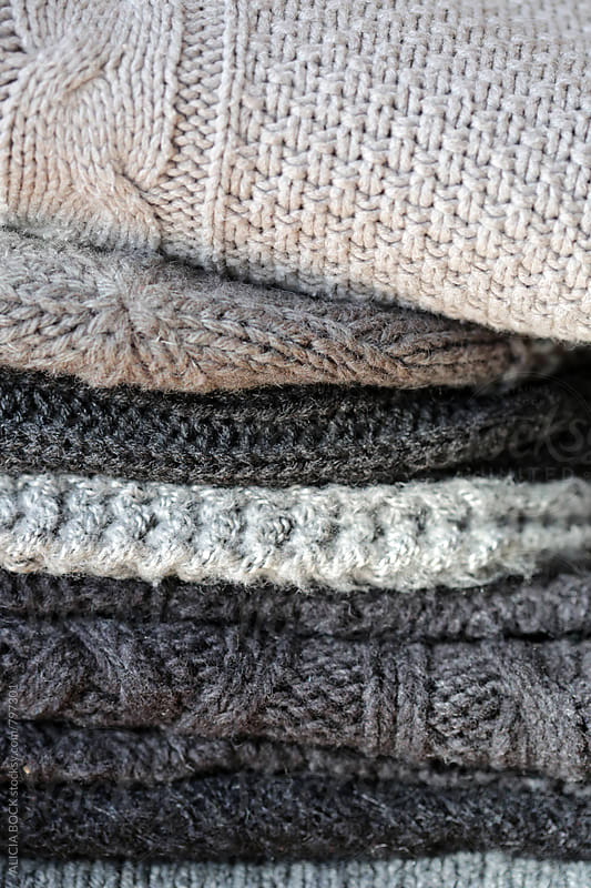 A Close Up Of A Pile Of Gray Winter Sweaters by ALICIA BOCK for Stocksy United