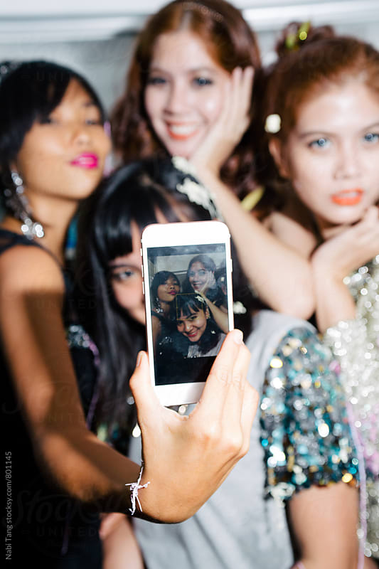 Party girls making selfie in the party by Nabi Tang for Stocksy United