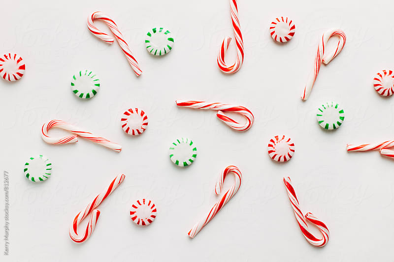 Peppermint candies arranged on white by Kerry Murphy for Stocksy United