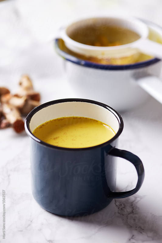 close-up of delicious and healthy turmeric golden milk tea by Martí Sans for Stocksy United