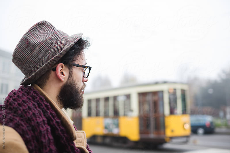 Commuter waiting for the tram by michela ravasio for Stocksy United