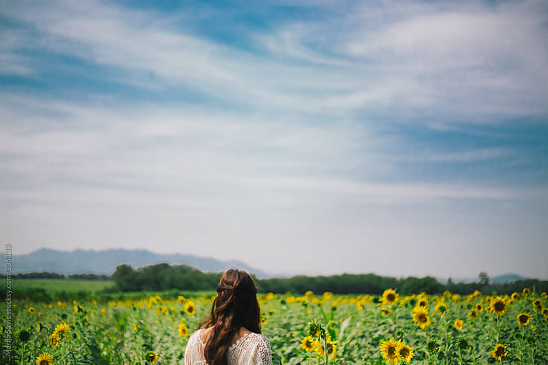 Woman in the sunflower field. by Marija Savic for Stocksy United