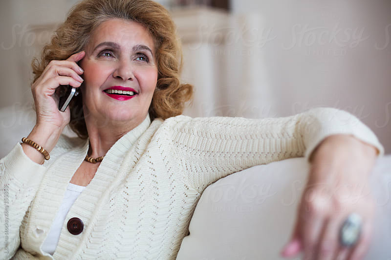 Senior Woman Making a Phone Call by Lumina for Stocksy United
