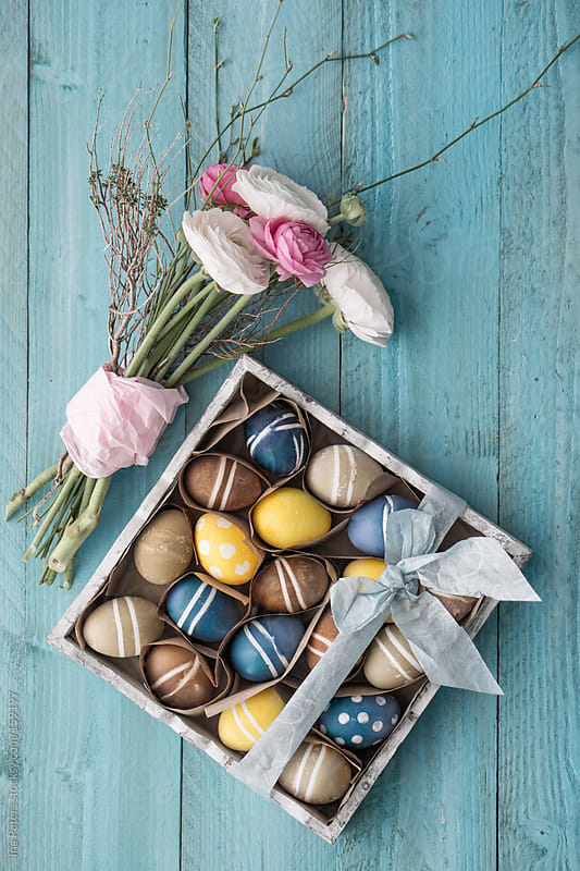 Easter: Vegetable Colored Eggs in a Box with Bunch of Spring Flo by Ina Peters for Stocksy United