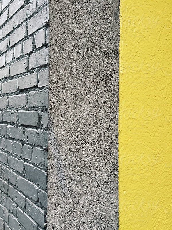 Detail of building corner with yellow stripe  by Paul Edmondson for Stocksy United