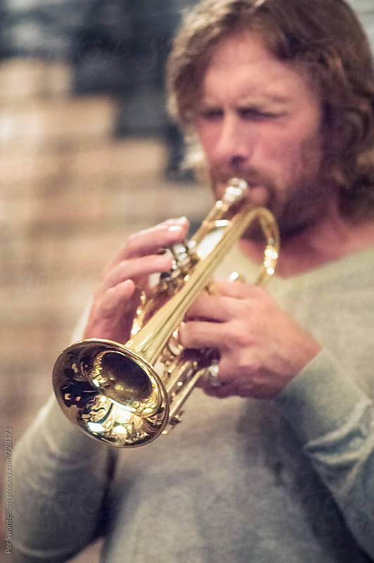 Portrait of trumpet musician by Per Swantesson for Stocksy United
