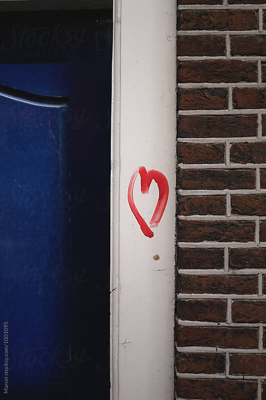 Red heart on doorpost by Marcel for Stocksy United