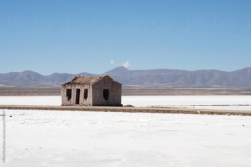 A disused building in a salt flat in a remote area. by Mike Marlowe for Stocksy United
