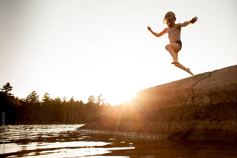 Little Boy Jumping Into Lake While Camping by JP Danko for Stocksy United