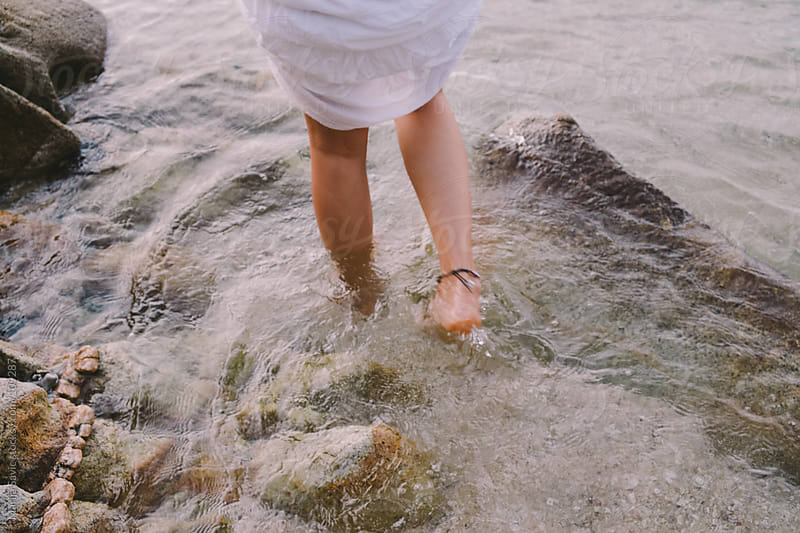 Woman's legs in the water. by Marija Savic for Stocksy United