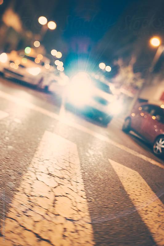 car shining on the zebra crossing by Javier Pardina for Stocksy United