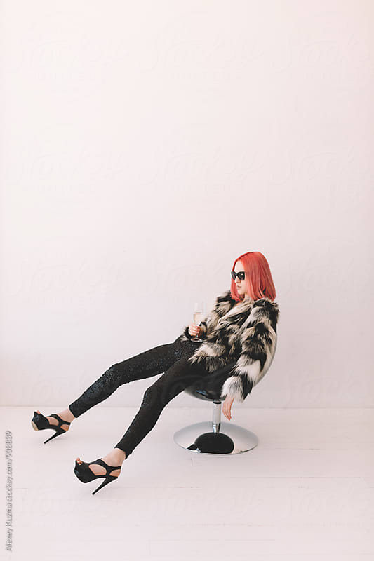 young woman with pink hair at home after the party by Vesna for Stocksy United