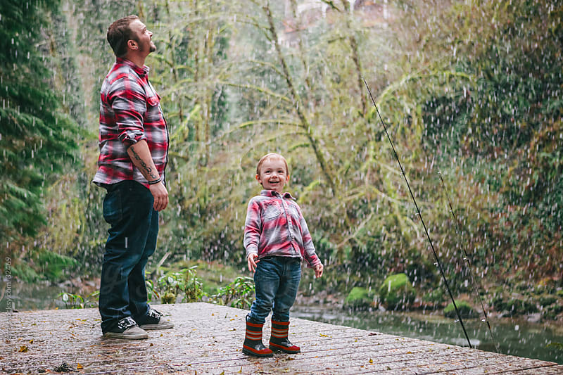 Little Boy with His Dad Excited for Falling Snow by Shelly Perry for Stocksy United
