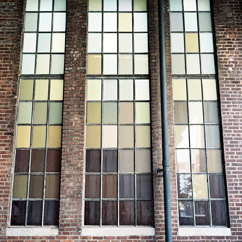 Large, green tinted warehouse windows by Riley Joseph for Stocksy United