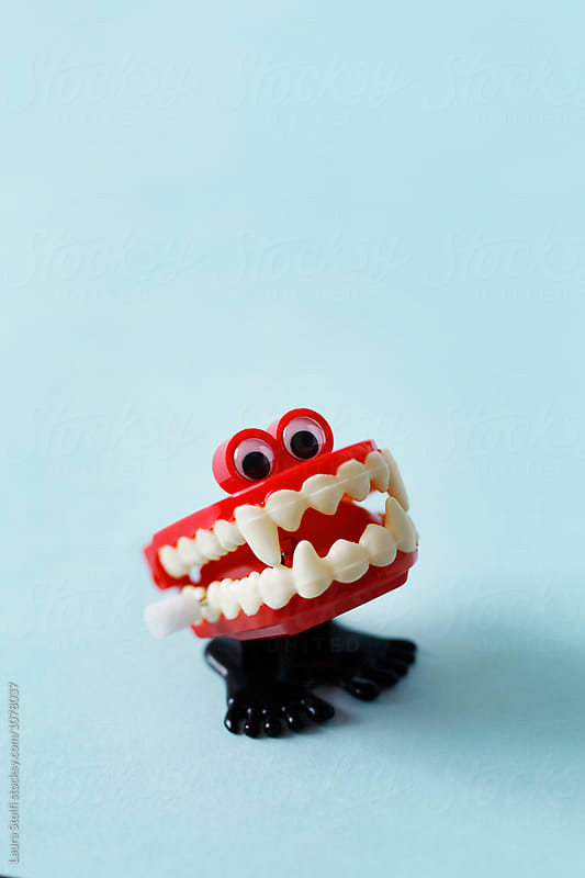 Close up of marching vampire's denture toy with googly eyes by Laura Stolfi for Stocksy United