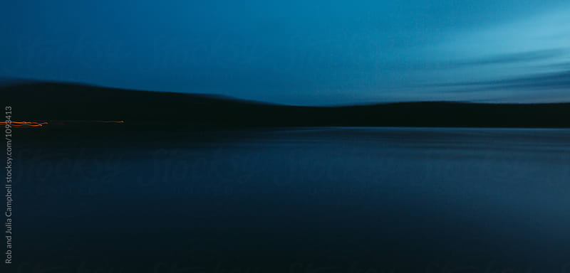 Water at dusk by Rob and Julia Campbell for Stocksy United