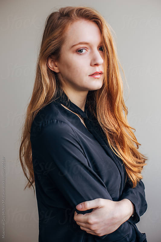 Beautiful young redhead in black by Maximilian Guy McNair MacEwan for Stocksy United